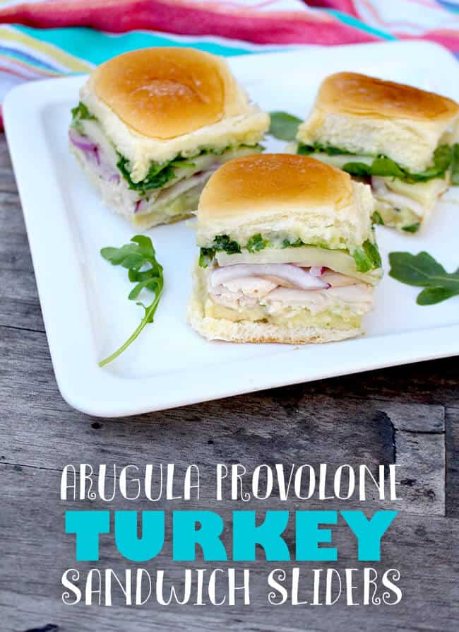 These Arugula Provolone Turkey Sandwich Sliders are amazing!! the turkey pairs perfectly with the sweet roll, nutty arugula, red onion and pesto mayonnaise.