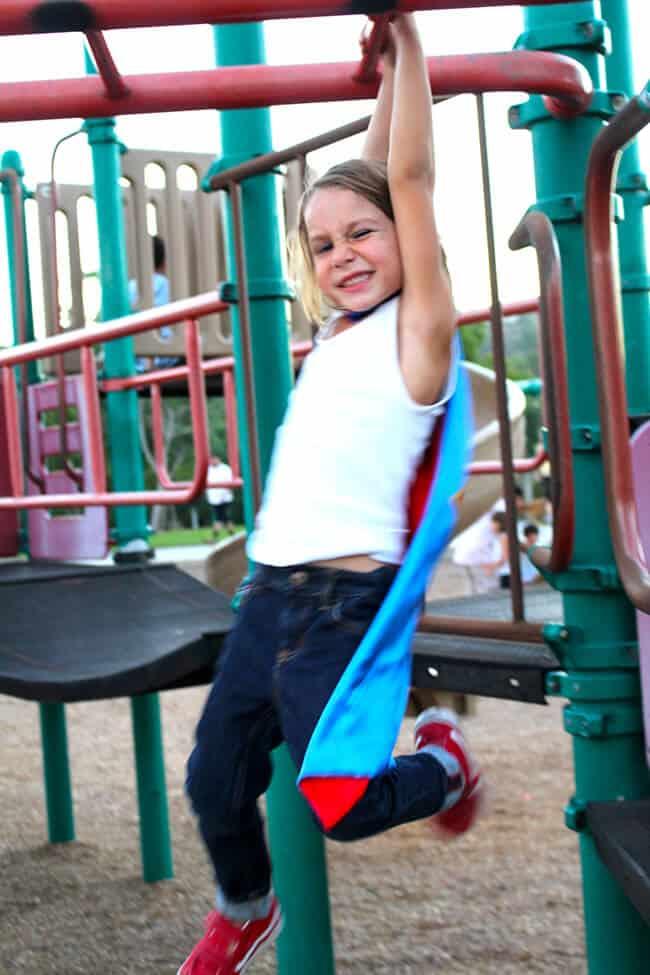 Little Boy Swinging on the Monkey Bars