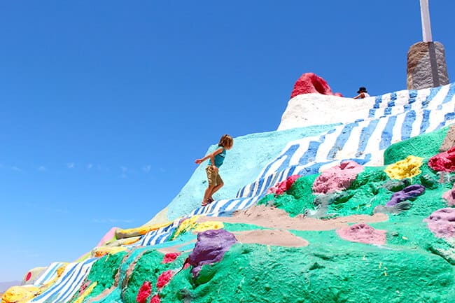 Climbing up Salvation Mountain