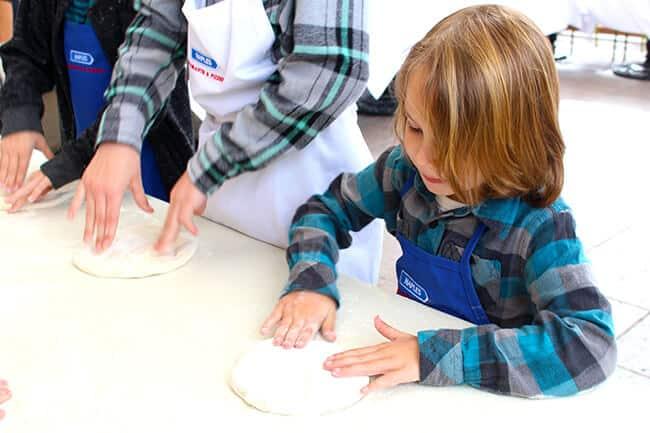Vann making a pizza